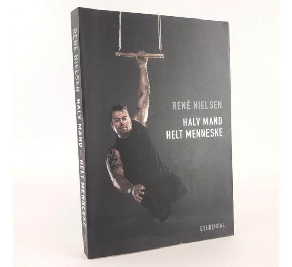 Halv mand helt menneske skrevet af René Nielsen